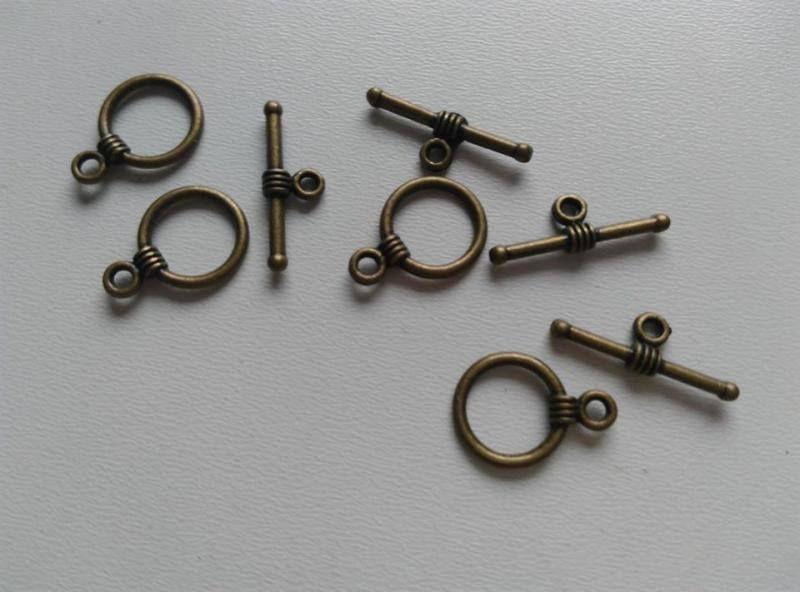 T-zár - karikás elem mérete: 16x11mm - sárgaréz szín (1 db)